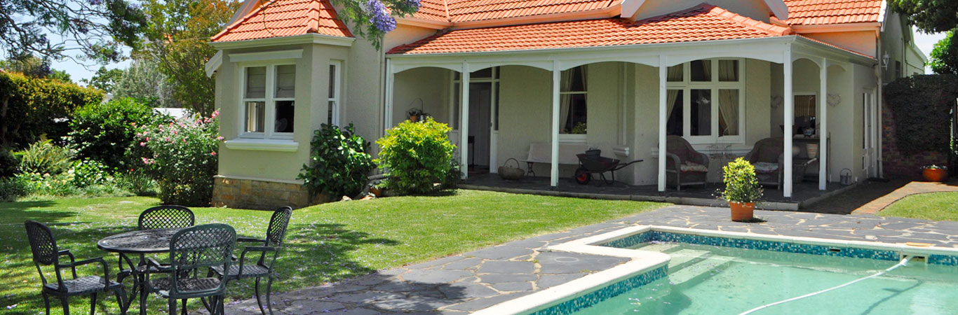 Selfcatering Cottage Claremont, CTN - french elegance set in a beautiful garden with sparkling pool - romantic cottage Claremont.