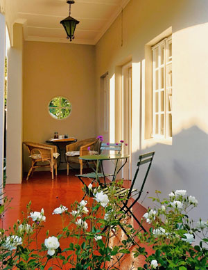Claremont Rose - the covered veranda is a lovely, peaceful spot to enjoy your morning coffee or even to eat a meal.